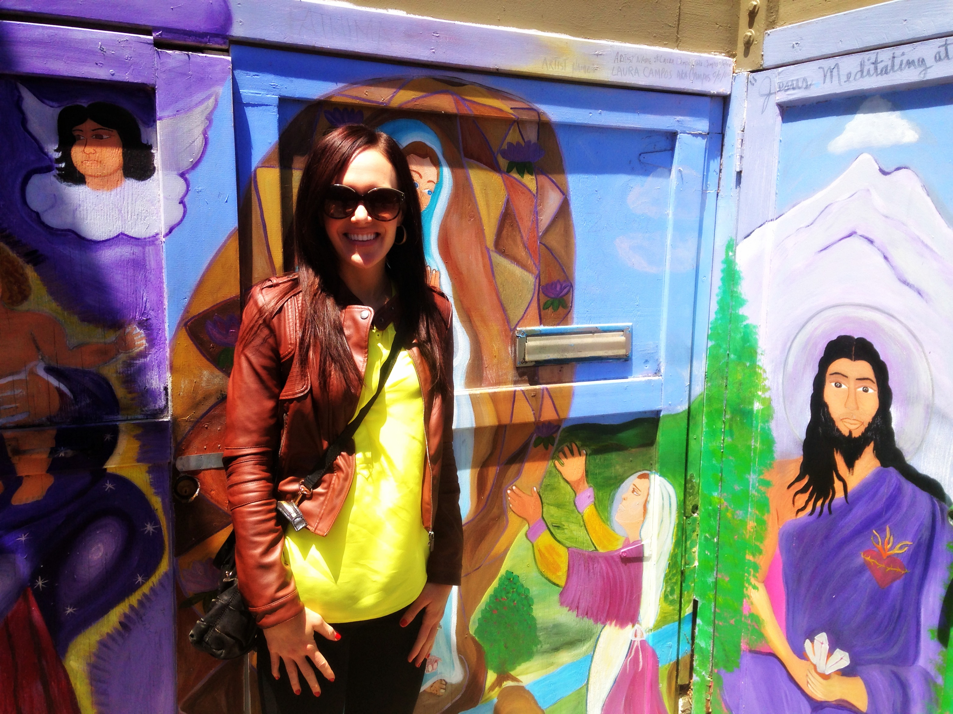 Ashley in front of murals