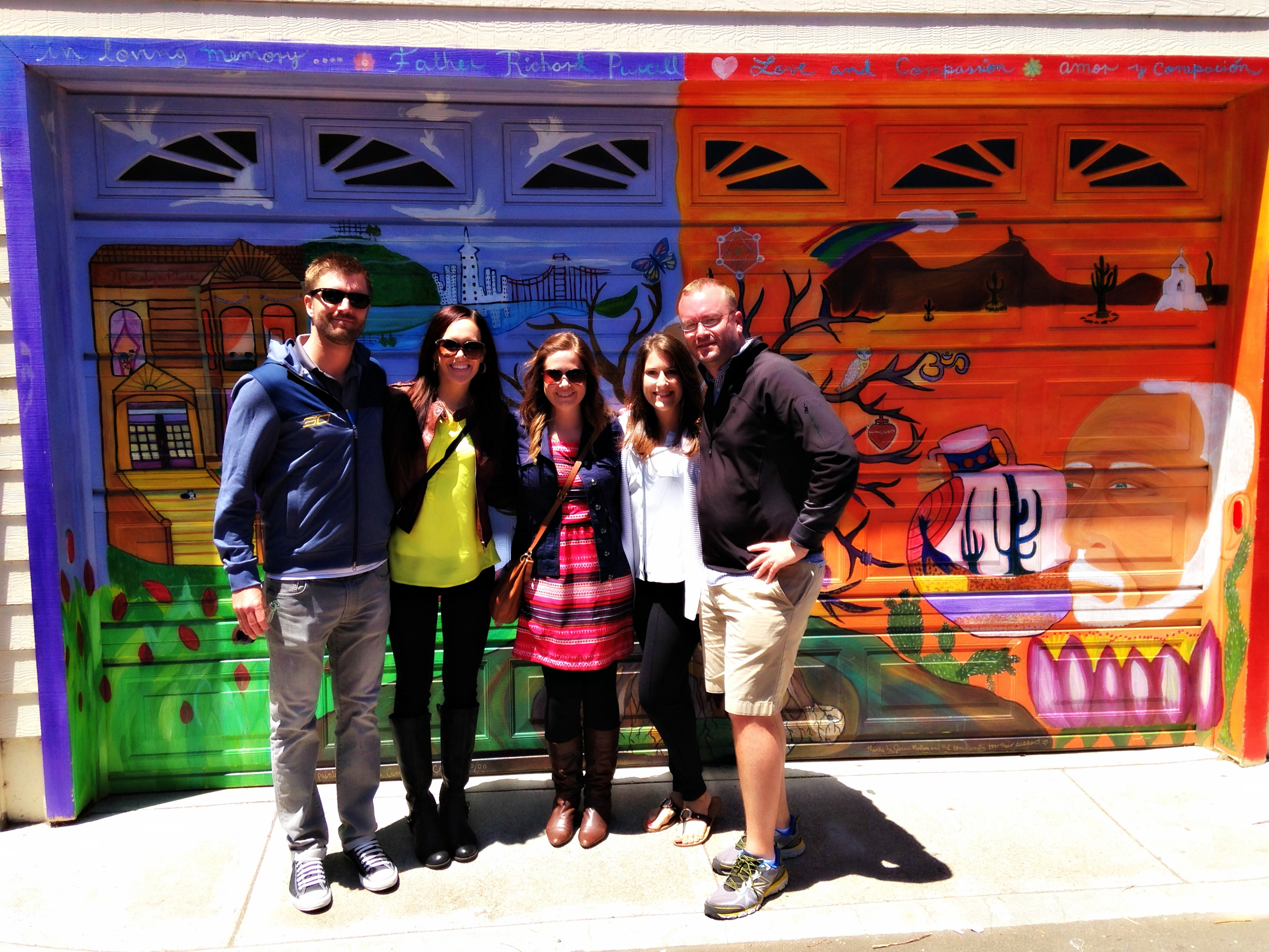 Group in front of murals