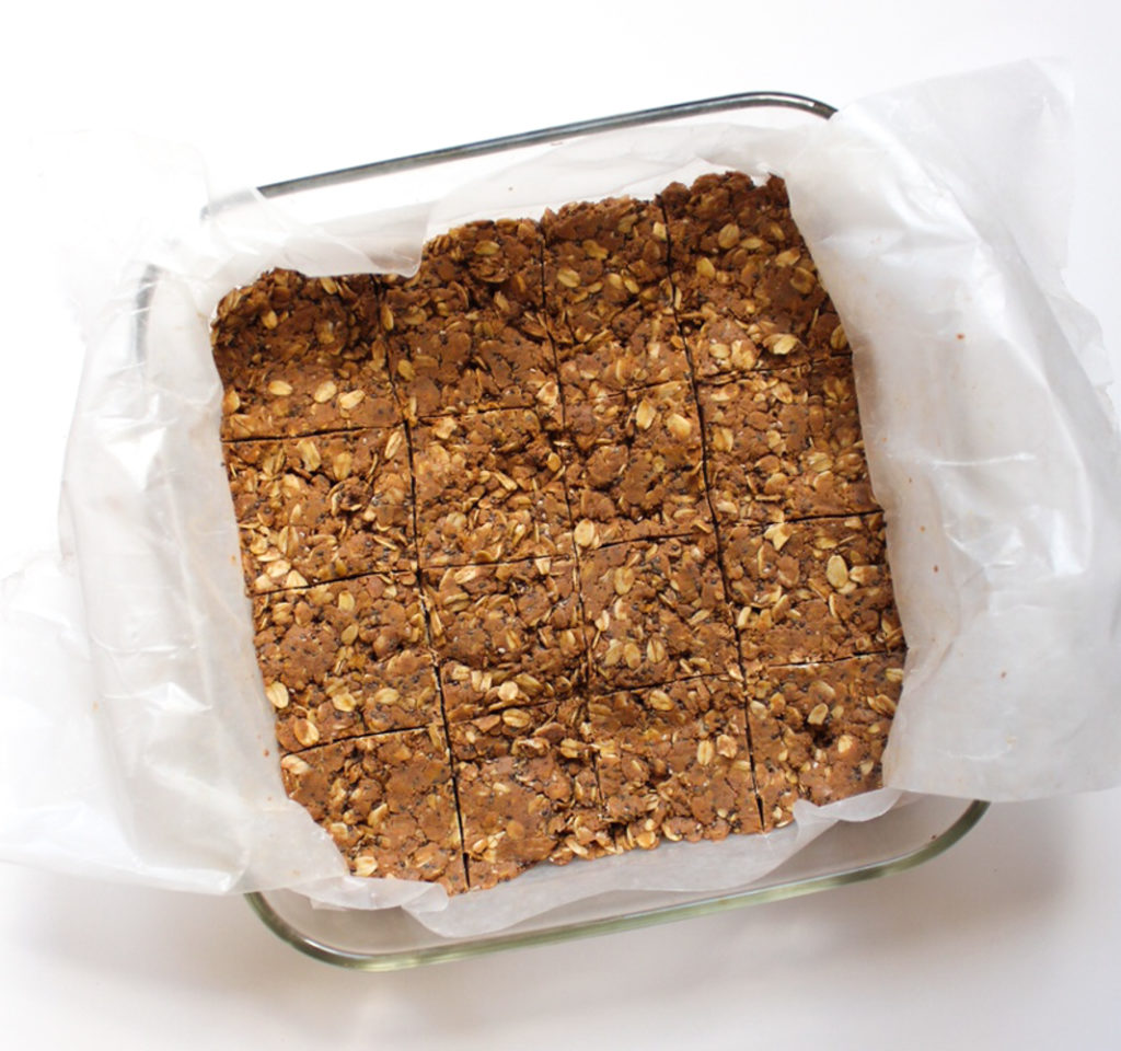 Chocolate peanut butter protein bars ingredients in pan A Lady Goes West