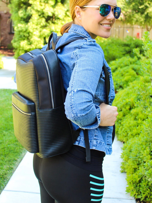 Ashley wearing a Doshi vegan leather backpack by A Lady Goes West