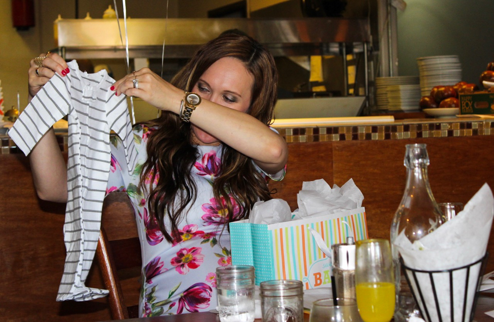 Baby clothes gifts at Rustic Tavern baby shower by A Lady Goes West