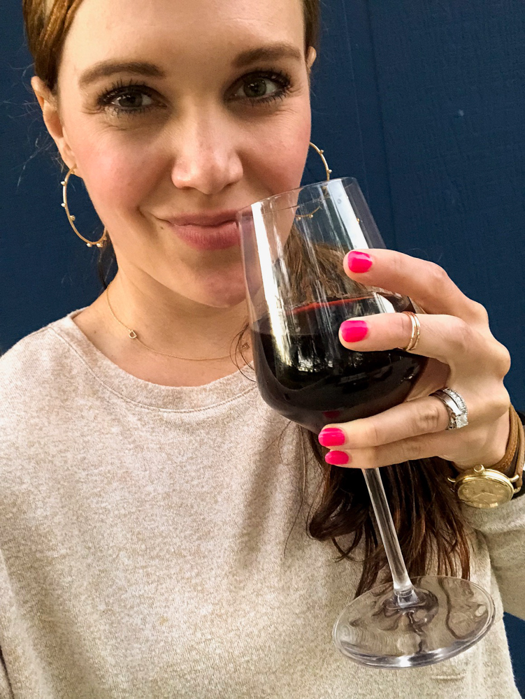 Ashley with red wine outside by A Lady Goes West