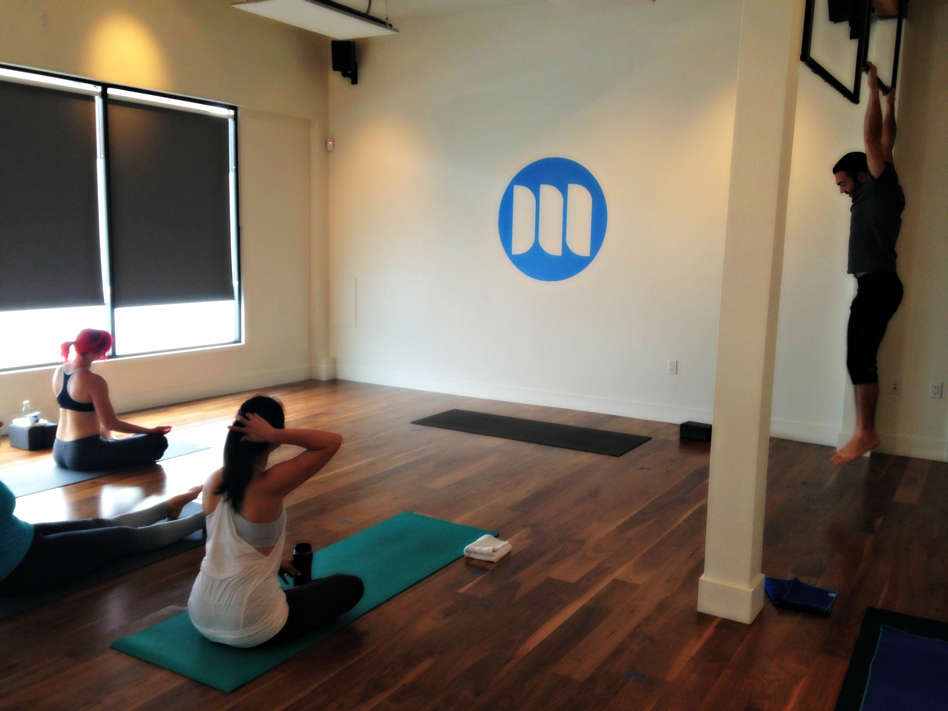 Moxie yoga studio inside with people