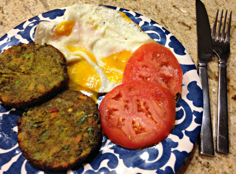 Dinner - veggie burgers, eggs and a tomato via A Lady Goes West