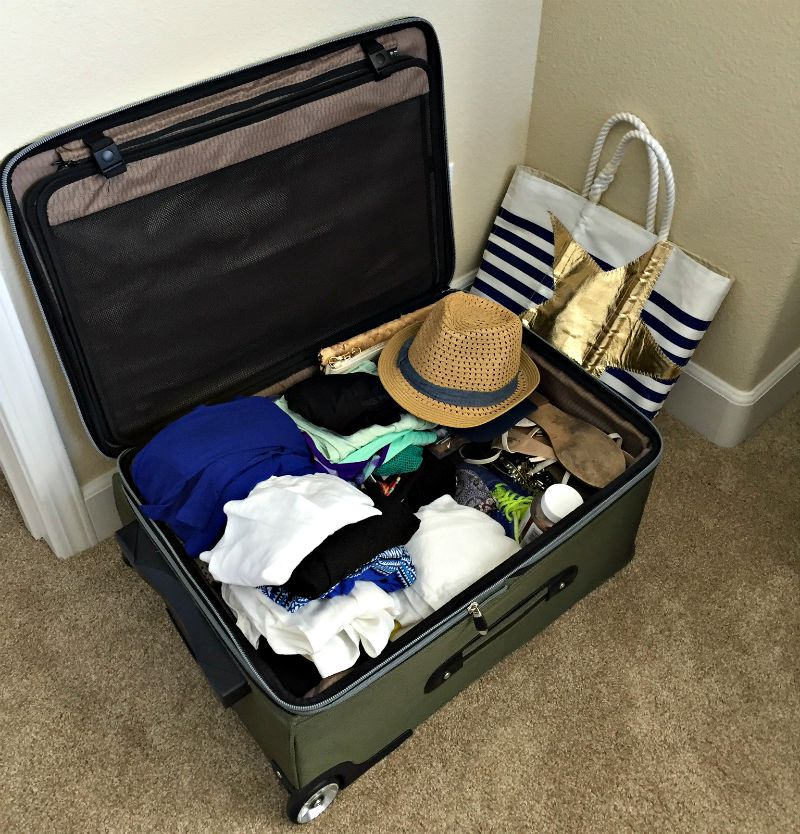 Packed suitcase via A Lady Goes West