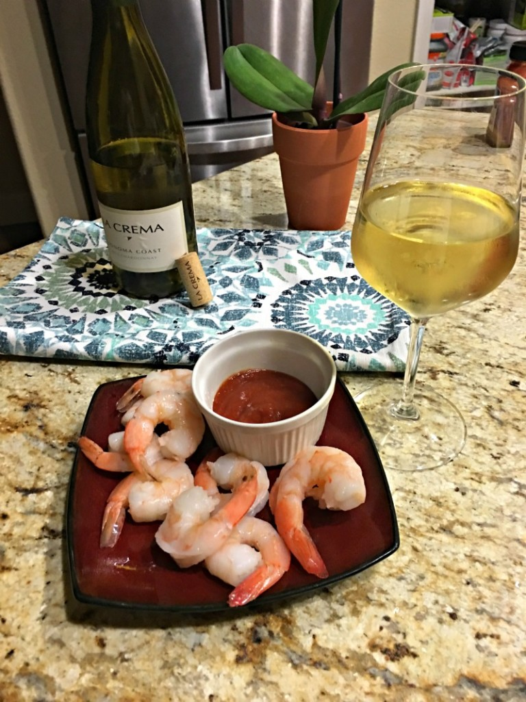 Shrimp cocktail and wine by A Lady Goes West