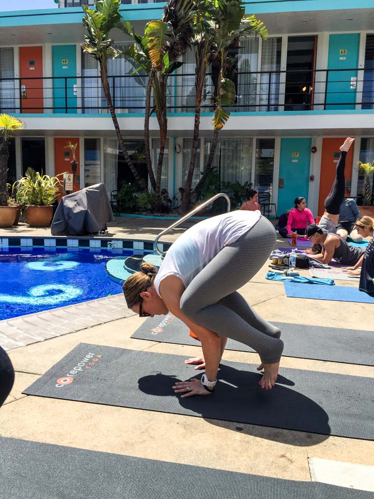 Launching into crow pose with CorePower by A Lady Goes West