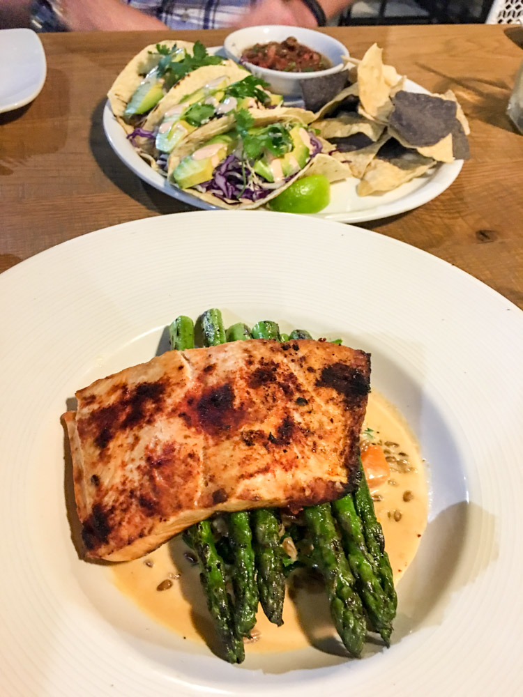 Salmon and fish tacos at California Pizza Kitchen by A Lady Goes West