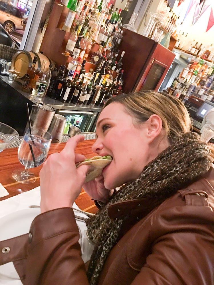 Ashley eating a taco by A Lady Goes West