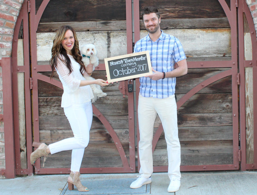 Baby and pregnancy announcement picture with sign by A Lady Goes West