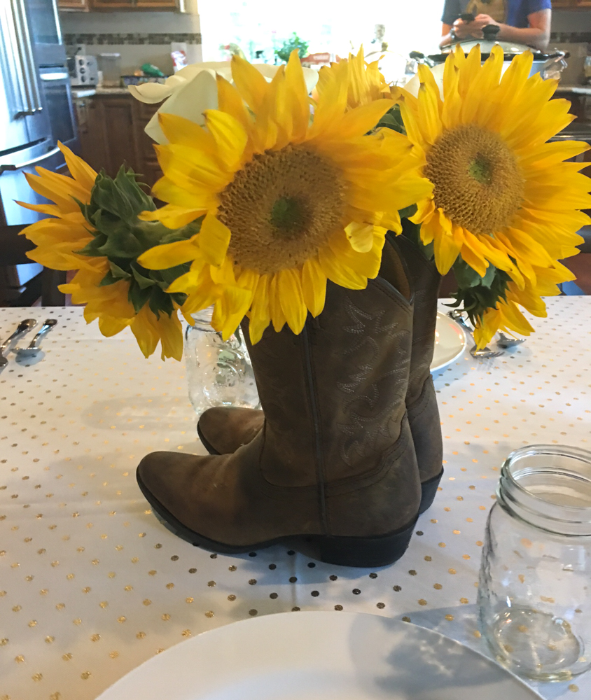 Boot centerpiece at the dinner party by A Lady Goes West