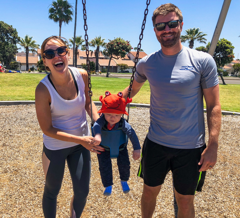 Family on the swing in Coronado by A Lady Goes West