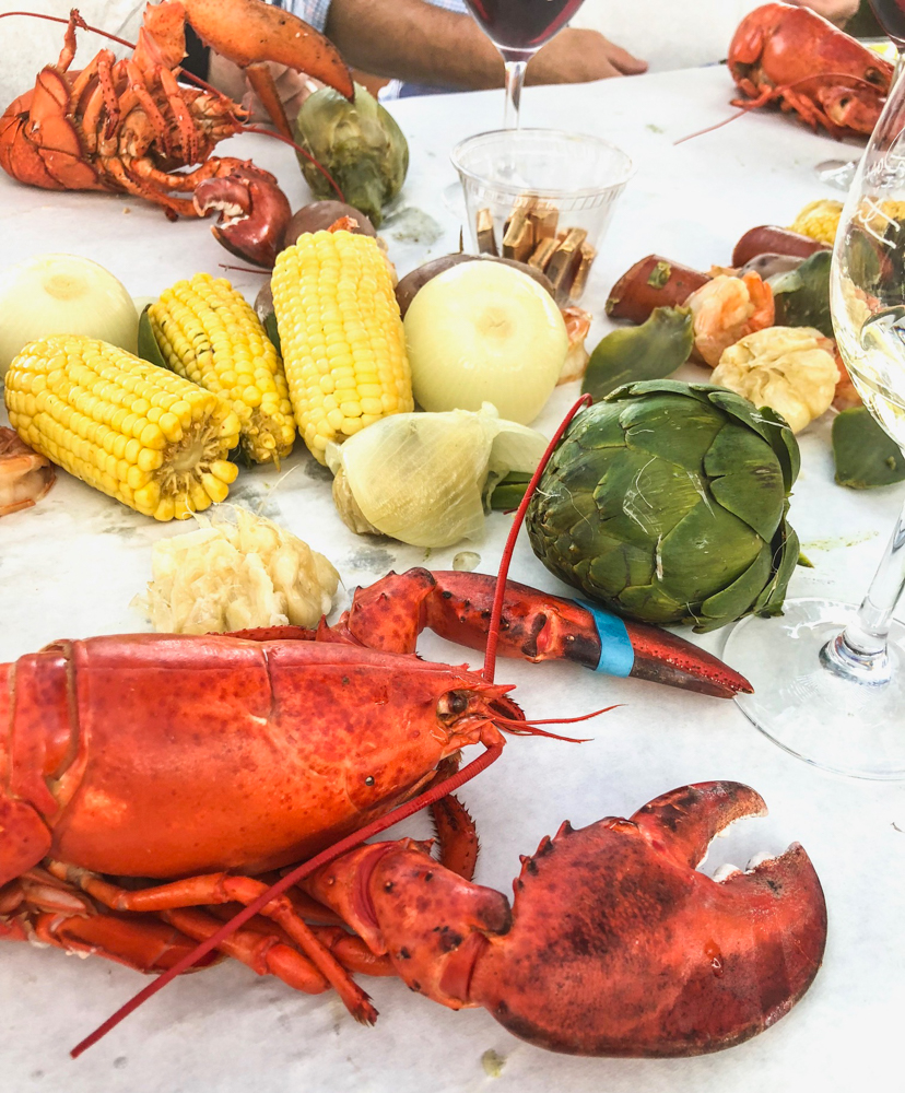 Table of food at the Livermore lobster bake with wine fave by A Lady Goes West