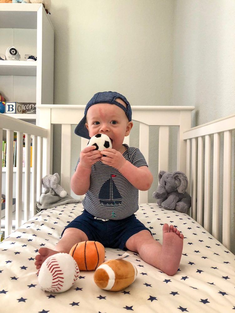 Brady at 10 months with a hat and balls by A Lady Goes Wes