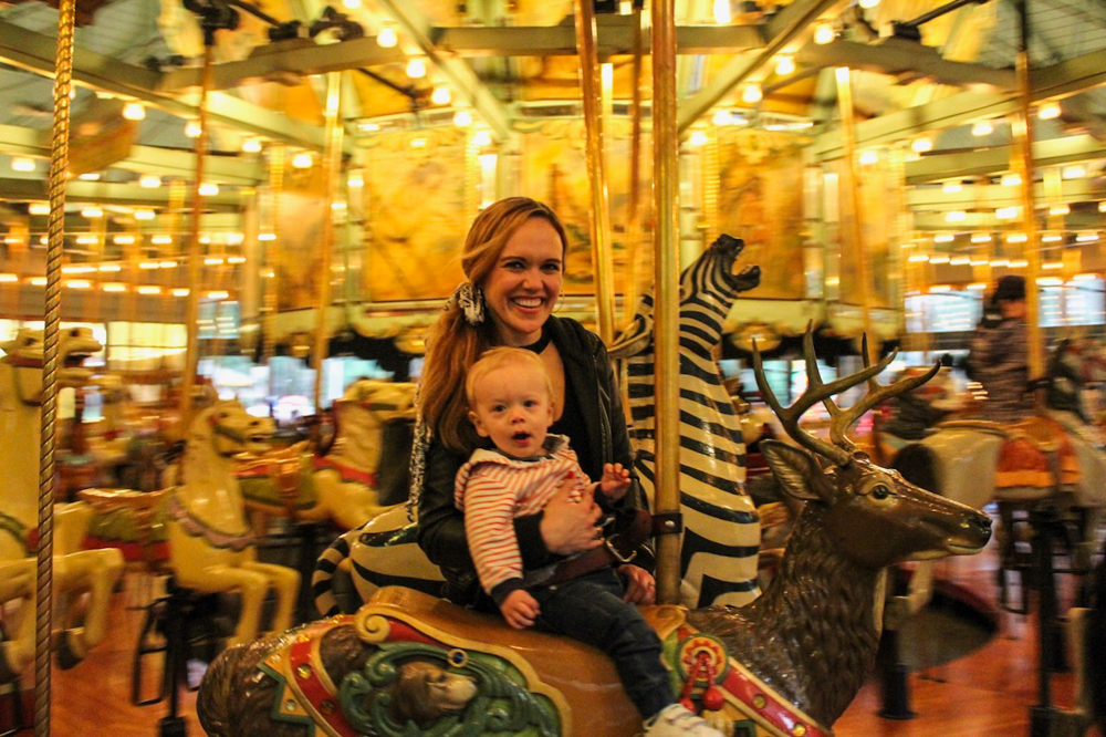 Ashley and Brady on the merry-go-round by A Lady Goes West -- December 2018