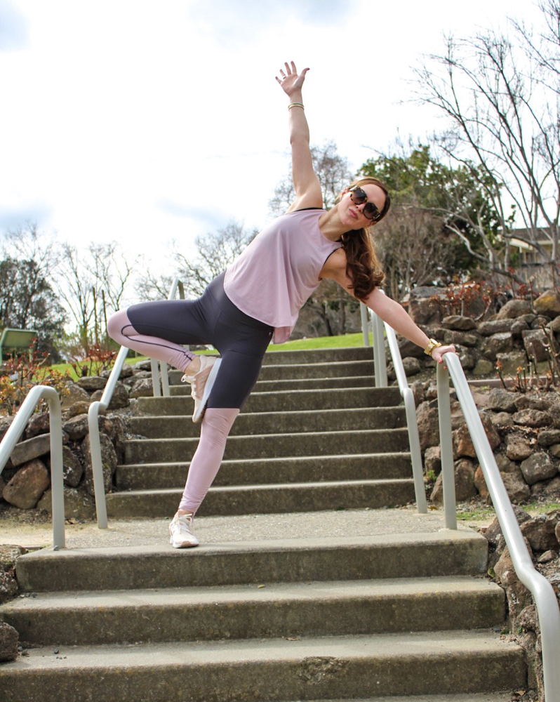 Ashley stretching in Fabletics workout outfit by A Lady Goes West