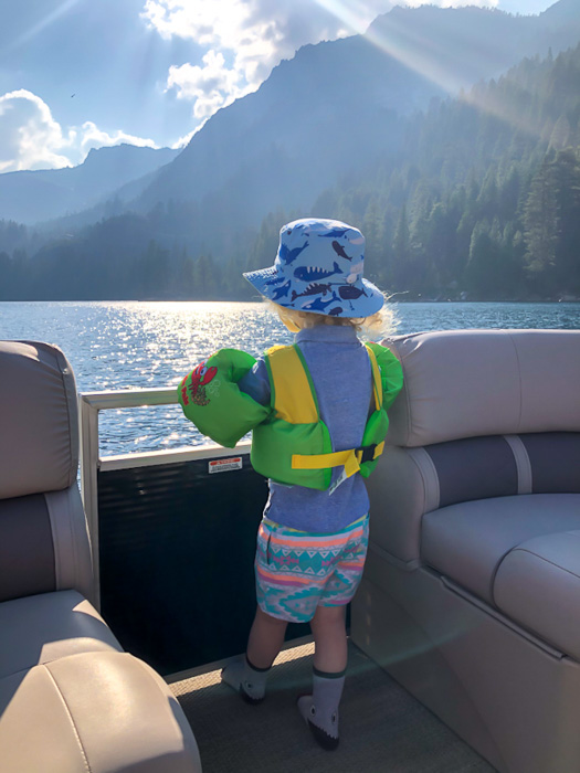Brady on boat at Emerald Bay Tahoe by A Lady Goes West