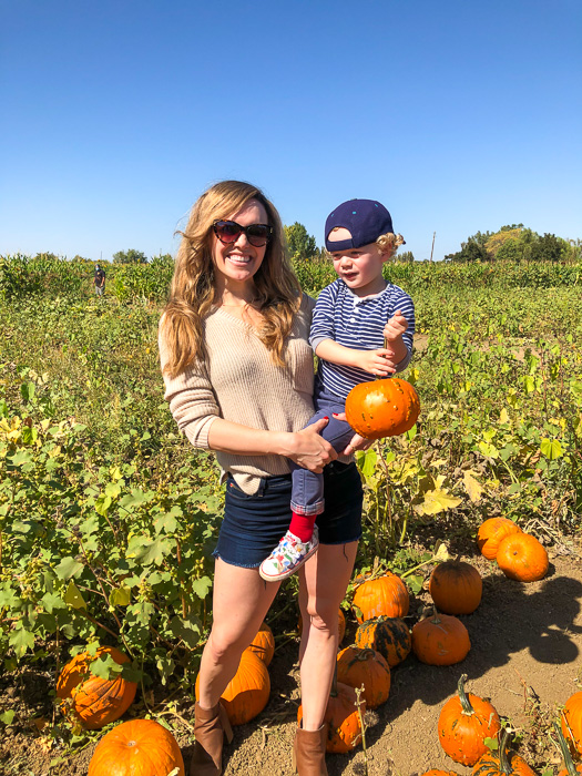 Ashley and Brady at pumpkin patch by A Lady Goes West