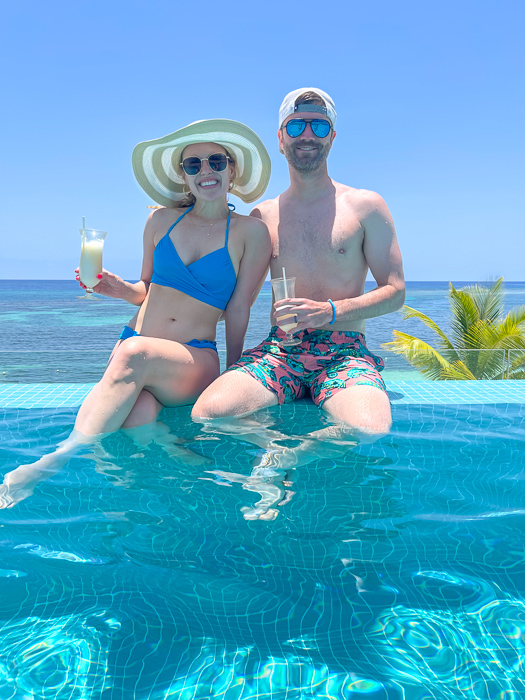 Ashley and Dave at the pool in Montego Bay in Jamaica by A Lady Goes West July 2021