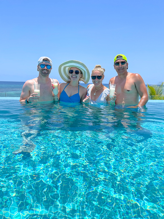 Group at the pool in Montego Bay in Jamaica by A Lady Goes West July 2021