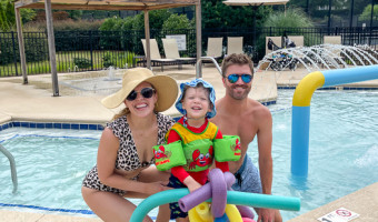 Family at pool by A Lady Goes West