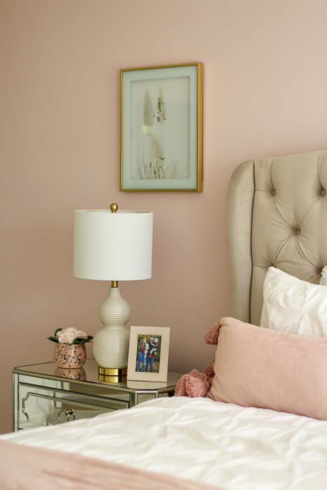 Pink wall primary bedroom by A Lady Goes West